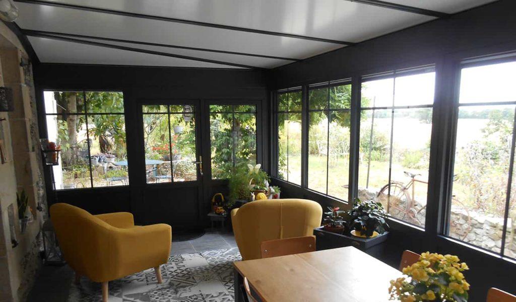 Véranda extension style atelier pour salle à manger - Réalisation Design vérandas à Falleron 85