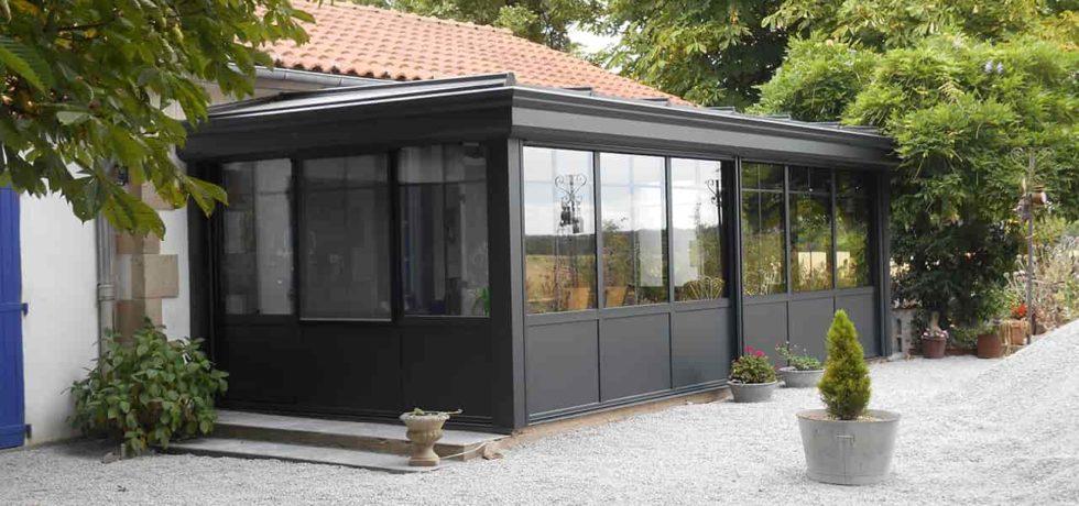 Véranda extension salle à manger style atelier - Réalisation Design vérandas à Falleron 85